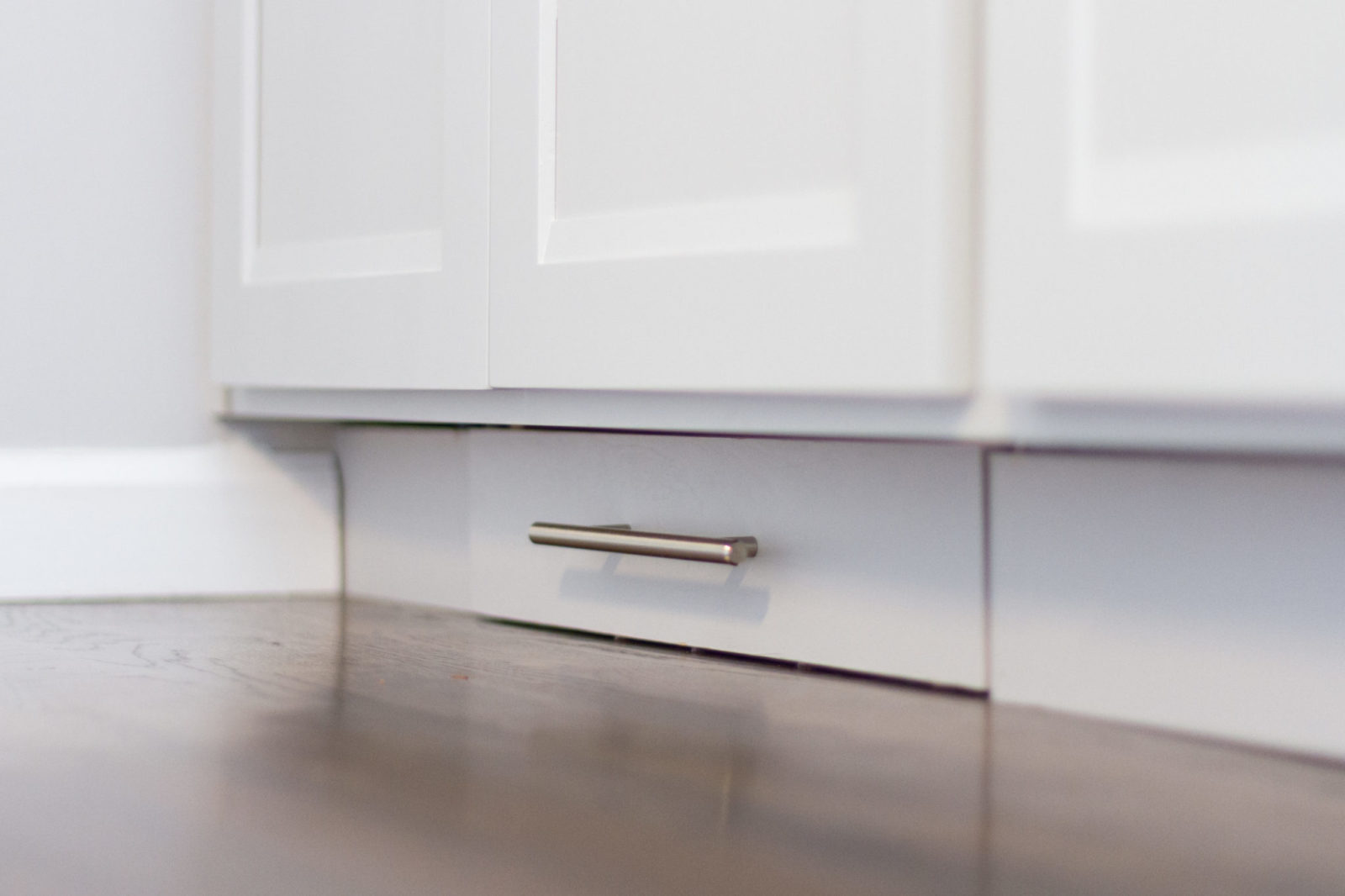 Doraville Kitchen Detail look at the Custom foot pull out step stool, installed under the cabinet.