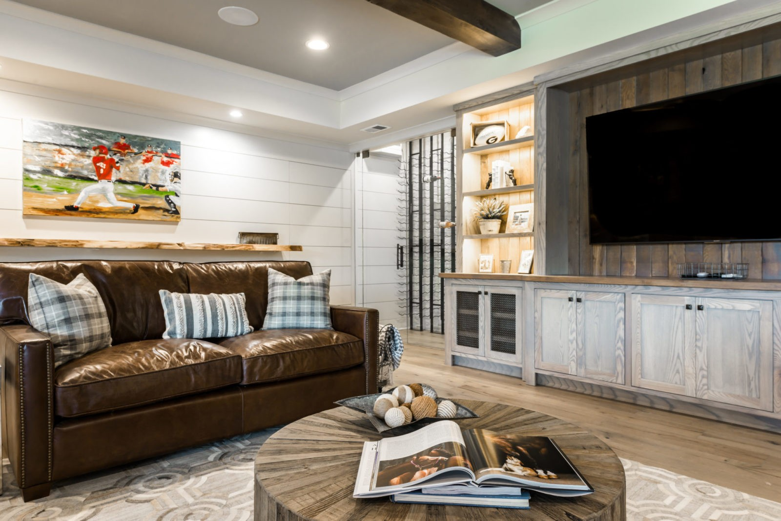 Custom shiplap walls Exposed rustic pine beams TV Cabinet custom with pickled ash stain