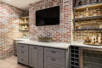 Farm House Modern Industrial Basement Remodel with Custom base cabinetry