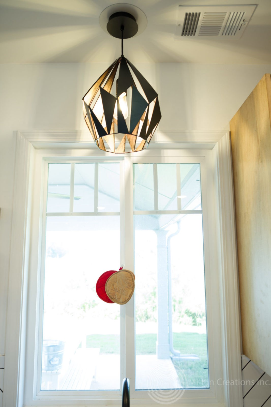 Modern Scandinavian Kitchen Remodel lighting above the kitchen sink.