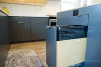 Modern Scandinavian Kitchen Remodel Lower Cabinets with pullout drawer for trash