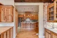 Custom Post Civil War kitchen with marble countertops and wood cabinets