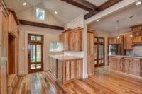 Mud Room area reveals custom cabinets and ceiling beams
