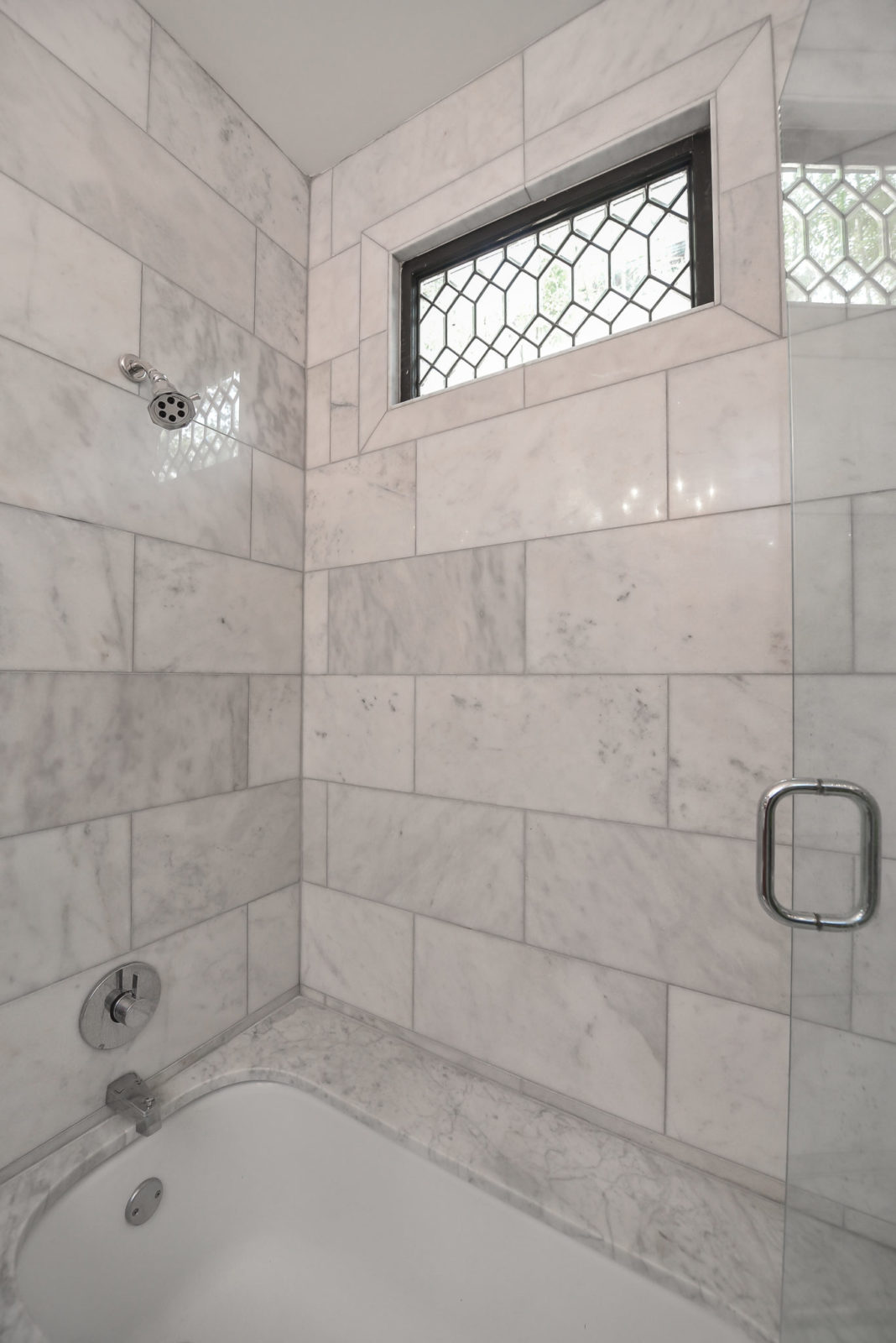 Custom marble tile shower and tub