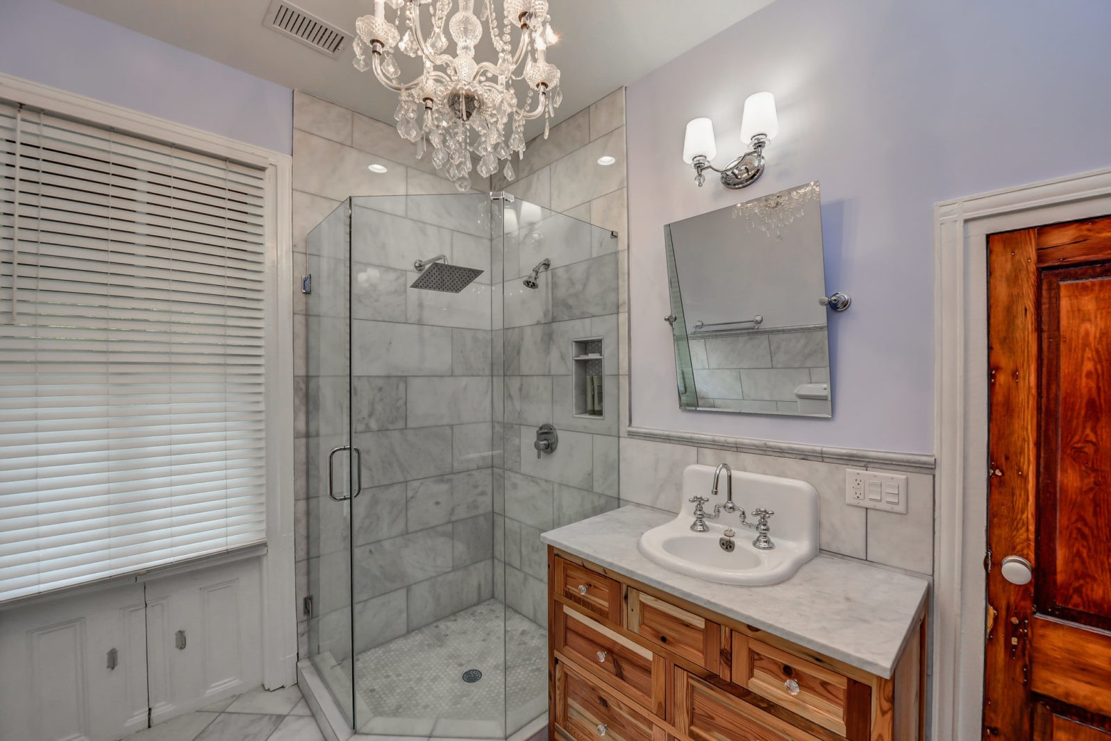 Post Civil War Custom Bathroom Remodel with marble floors, glass shower, wood vanity with marble top