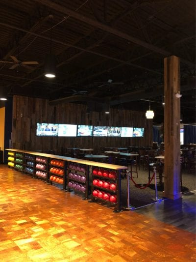 Bowling ball holder, bar, and custom wall pallet with hanging tvs