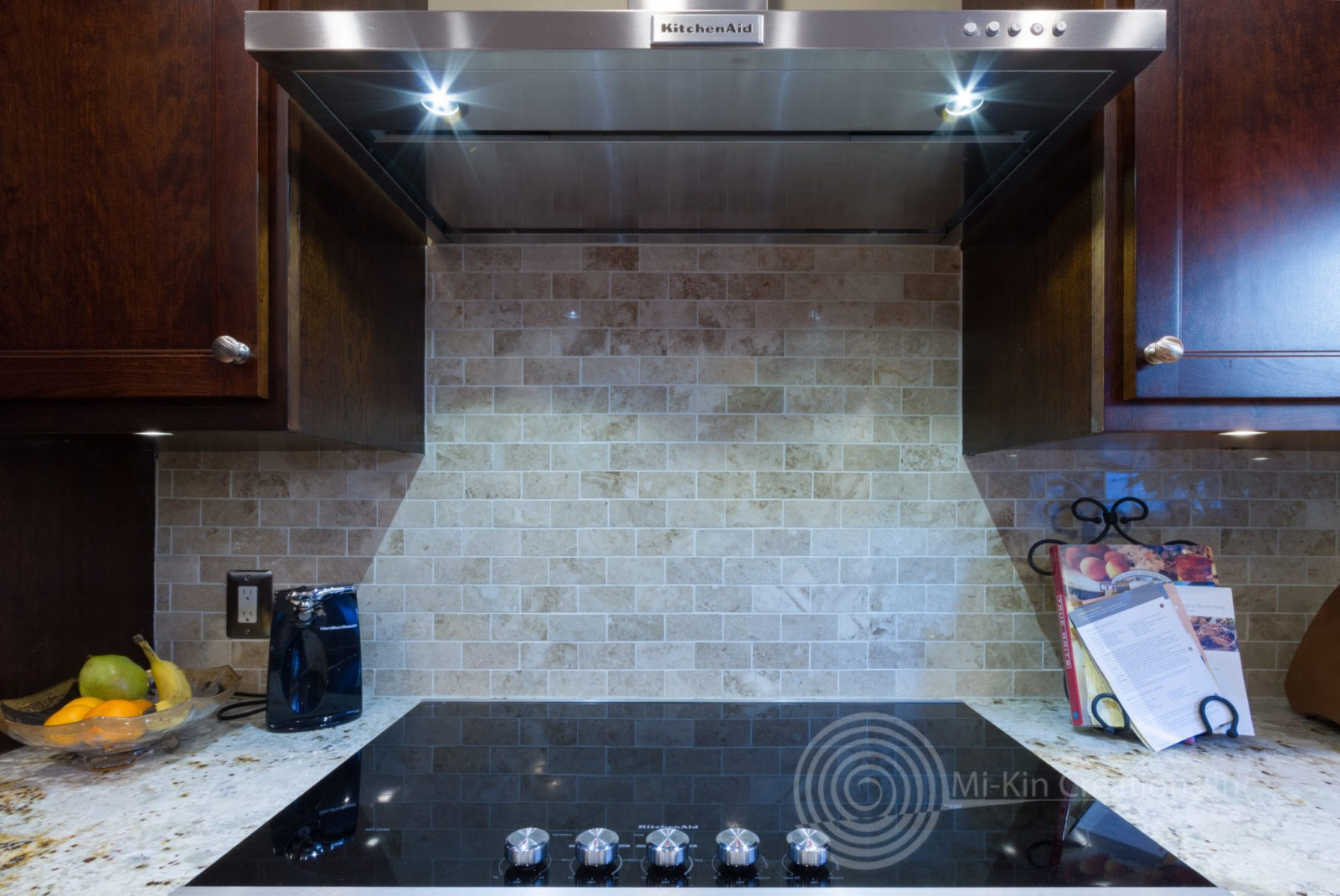 Electric range with stainless vent hood