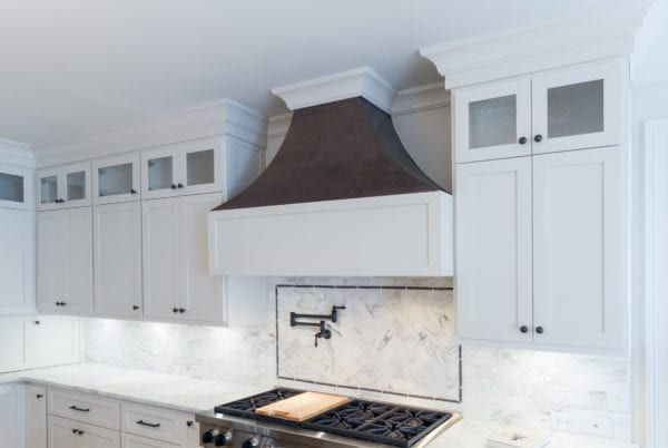 Tuscan inspired kitchen stove with vent hood