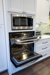Double stove cabinet inserts with a shaker kitchen feel